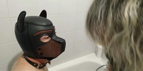 Mistress Paloma baptizes Romulus the dog